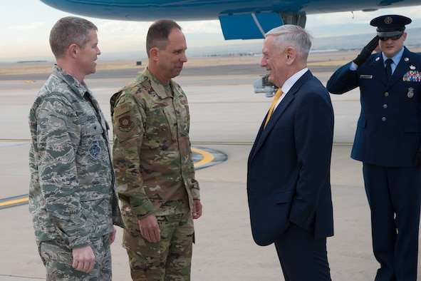 PETERSON AIR FORCE BASE, Colo. - (From left to right) Col. Sam Johnson, 21st Space Wing vice commander, and Maj. Gen. John Shaw, Air Force Space Command deputy commander, greet Defense Secretary James Mattis on the fight line at Peterson Air Force Base, Colo., Nov. 30, 2018. Mattis was in Colorado Springs to meet with senior cadets at the U.S. Air Force Academy. (U.S. Air Force photo by Robb Lingley)