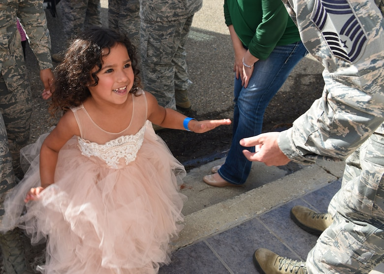 Team Vandenberg greets the children participating in Operation Kids Christmas, at the Pacific Coast Club at Vandenberg Air Force Base, Calif. Dec. 1, 2018. Vandenberg hosts the 59th annual Operation Kids Christmas here, expecting 200 kids from nearby cities to partake in the planned games, crafts, lunch and Christmas gifts.
