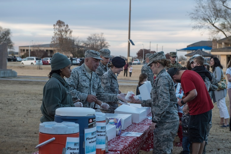 Members of the 97th Air Mobility Wing partake in festivities at the annual holiday tree lighting event, Nov. 29, 2018, at Altus Air Force Base, Okla. The event is hosted by the 97th Force Support Squadron in order to bring members of the military community together during the holidays. (U.S. Air Force photo by Senior Airman Cody Dowell)