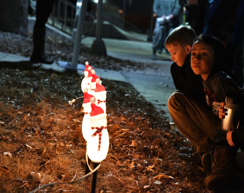 Children listen to a speech during a tree lighting ceremony at the Freedom Chapel on Ellsworth Air Force Base, S.D., Nov. 30, 2018. Airmen and their families came out to celebrate the lighting of the base tree and to start the holidays in a festive and family-friendly environment where multiple religions were represented. (U.S. Air Force photo by Airman 1st Class Thomas Karol)