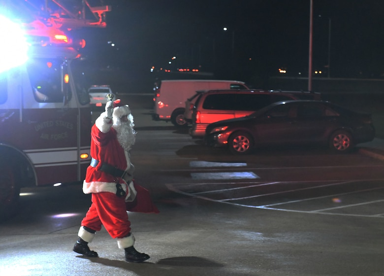 Santa Claus visits the 28th Bomb Wing during a tree lighting ceremony at the Freedom Chapel on Ellsworth Air Force Base, S.D., Nov. 30, 2018. Airmen and their families came out to celebrate the lighting of the base tree and to start the holidays in a festive and family-friendly environment where multiple religions were represented. (U.S. Air Force photo by Airman 1st Class Thomas Karol)