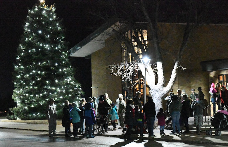 Members of the 28th Bomb Wing gather for a tree lighting ceremony at the Freedom Chapel on Ellsworth Air Force Base, S.D., Nov. 30, 2018. Airmen and their families came out to celebrate the lighting of the base tree and to start the holidays in a festive and family-friendly environment where multiple religions were represented. (U.S. Air Force photo by Airman 1st Class Thomas Karol)