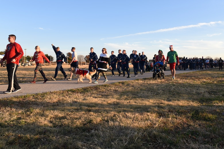 Participants in the Jingle Bell 5K start their run Prior to the Tree Lighting Ceremony at the parade field at Goodfellow Air Force Base, Texas, Dec. 4, 2018. The run was open to the squadrons on base who used the event as physical training and a way to boost morale, it was also open to those who had base access. (U.S. Air Force photo by Airman 1st Class Zachary Chapman/Released)