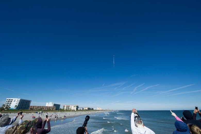 People watch SpaceX's Falcon 9 rocket CRS-16 lift off from Cape Canaveral Air Force Station, Space Launch Complex 40 on Dec 5, 2018 at Cocoa Beach, Fla. The CRS-16, a cargo resupply mission to the International Space Station, carried more than 5,600 pounds of supplies to the ISS, including 250 research and science projects. (U.S. Air Force photo by Airman 1st Class Dalton Williams)