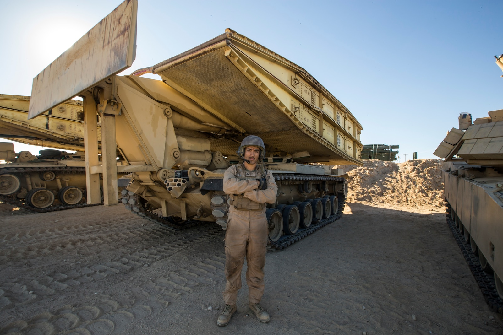 U.S. Marine Corps Cpl. Gerardo, Parra, an Assault Breacher Vehicle Joint Assault Bridge Operator, with 1st Combat Engineer Battalion, 1st Marine Division poses for a photo during exercise Steel Knight (SK) 2019 at Marine Corps Air Ground Combat Center, Twentynine Palms, California, Nov. 28, 2018