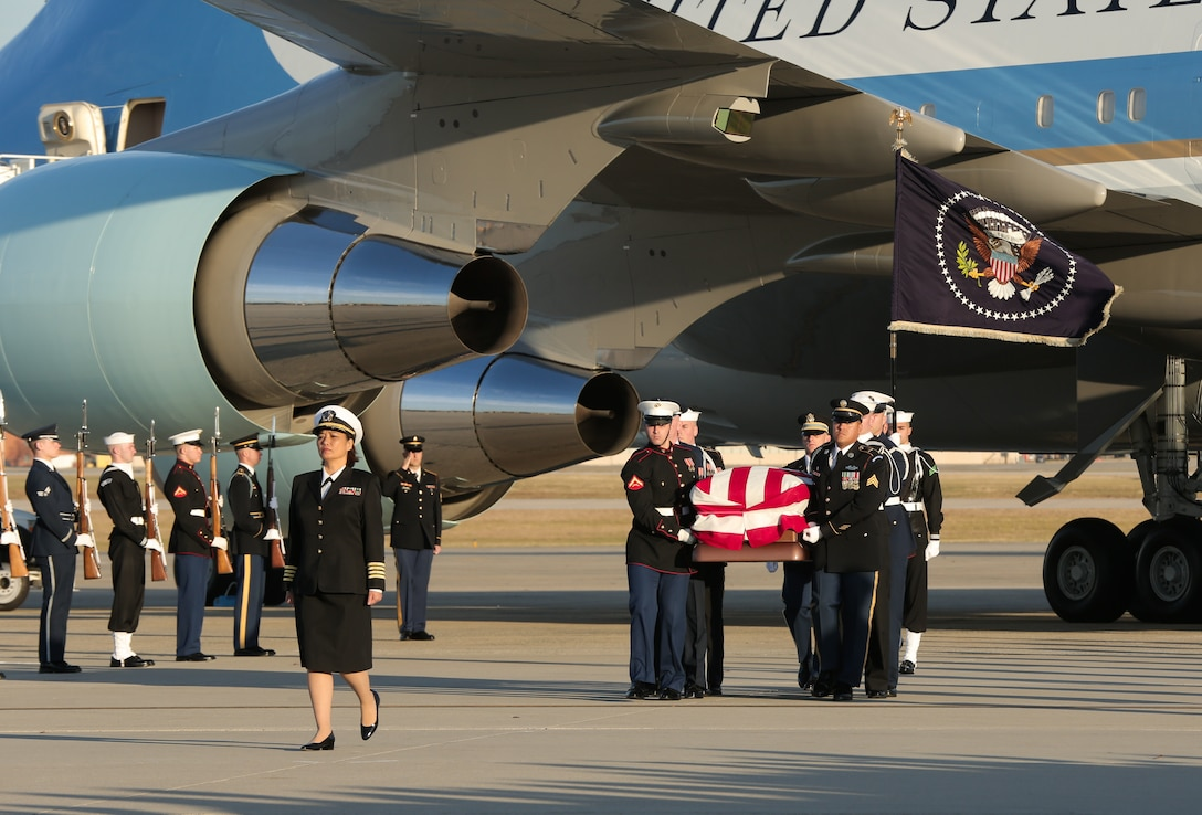 U.S. service members carry the casket of President George H.W. Bush at Joint Base Andrews, Maryland.