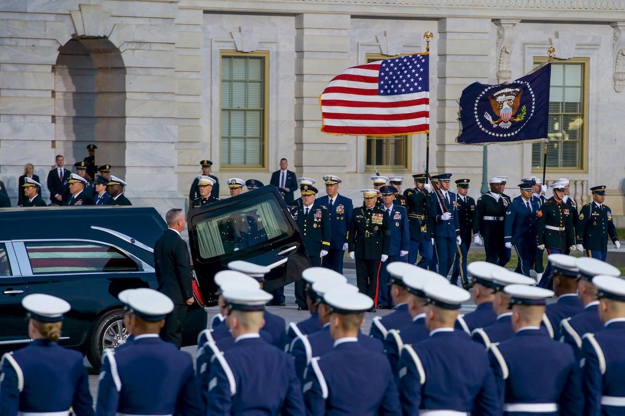 U.S. service members prepare to carry the casket of George H.W. Bush