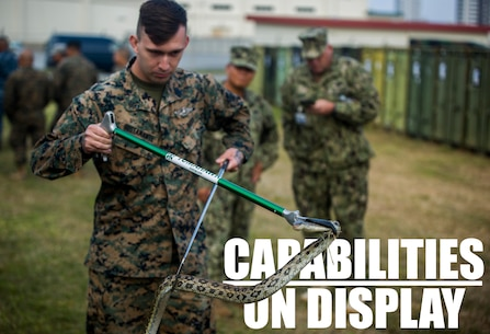 U.S. Navy Hospital Corpsman 2nd Class John Bustamante handles a habu snake during a preventive medicine course as part of a capabilities display Nov. 29, 2018 at Camp Foster, Okinawa, Japan. The preventive medicine snake relocation course allowed Sailors to practice safely relocating reptiles from areas where they pose a threat. Sailors with 3rd Medical Battalion, 3rd Marine Logistics Group, established a Role II capabilities display to give service members the opportunity to view their full facilities. Preventive medicine technicians displayed and offered courses on their food and water sanitation test, snake relocation and entomology surveillance capabilities. Bustamante, a corpsman with 3rd Medical Bn., 3rd MLG, is a native of Killeen, Texas. (U.S. Marine Corps photo by Lance Cpl. Mark Fike)