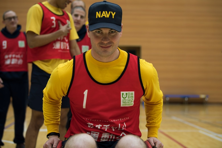 U.S. Navy Petty Officer 2nd Class Wayne Swindell, a Naval Air Facility security department watch commander, pushes himself in a wheelchair during the Misawa City Paralympics tribute game at the Misawa International Sports Center in Misawa City, Japan, Dec. 1, 2018. Kazumasa Taneichi, the Misawa City mayor, invited Misawa Air Base military members to participate in a Paralympic event in honor of the official Paralympics in Tokyo in 2020. (U.S. Air Force photo by U.S. Navy Petty Officer 2nd Class Bryan Mai)