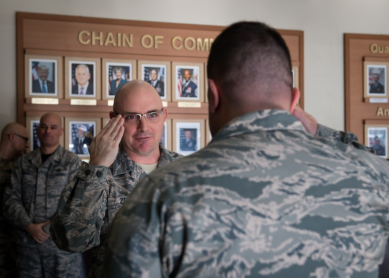 U.S. Air Force Senior Master Sgt. Michael Zeigler, flight chief assigned to the 51st Logistics Readiness Squadron, salutes Col. William Betts, 51st Fighter Wing commander, after being notified of his promotion to chief master sergeant on Osan Air Base, Republic of Korea, Nov. 30, 2018.