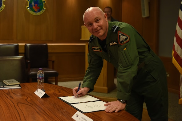 Air Vice-Marshal Harv Smyth, Air Officer Commanding No. 1 Group signs the Combat Air Interoperability Working Group Charter, Nov. 27, 2018, at RAF Lakenheath, U.K. The charter outlines operational integration of advanced fighters and training infrastructure. (U.S. Air Force photo by Airman 1st Class Christopher S. Sparks)