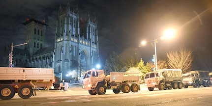 District of Columbia National Guard Soldiers create a security barrier using light medium tactical vehicles in front of the Washington National Cathedral prior to the state funeral for 41st U.S. President George H.W. Bush, Dec. 5, 2018.