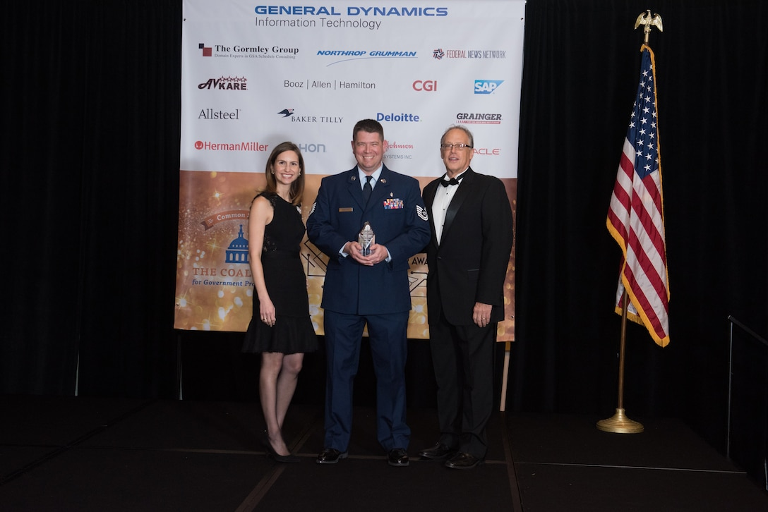 Tech. Sgt. James Sempter accepts his Excellence in Partnership Acquisitions Savings Award from the Coalition for Government Procurement on Nov. 7, 2018 in Falls Church, Va. Each year, the award is given by the Coalition for Government Procurement and is presented to one person, chosen from federal agencies like the Department of Defense, who has developed ways to save the federal government money. (Photo courtesy of Susan Hornyak)