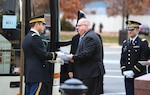 Maj. Joshua Behsudi, Mobilization Augmentation Command branch chief, hands Maryland Gov. Larry Hogan an invitation to the state funeral for 41st U.S. President George H.W. Bush prior to departing to the Washington National Cathedral Dec. 5, 2018.