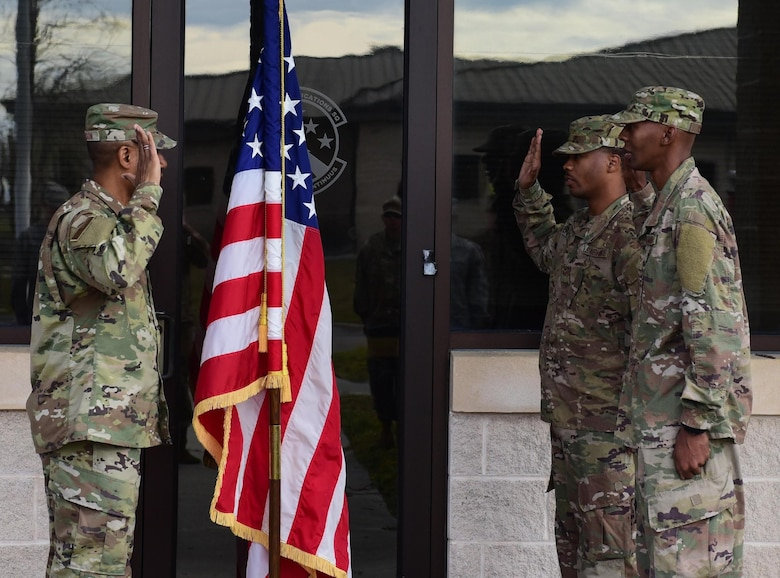 Air Force Maj. James Johnson, 325th Communication Squadron commander, gives the oath of enlistment to Staff Sgt. Abrahm Paulding (center) and Senior Airman Antoine Brown (right), 325th CS cyber systems supervisors, during their reenlistment ceremony at Tyndall Air Force Base, Fla., Nov. 30, 2018. The ceremony was the first to take place on Tyndall since Hurricane Michael hit in October. (U.S. Air Force photo by Senior Airman Cody R. Miller)