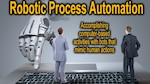 A graphic of two men in suits standing on an oversize keyboard with a robot hand approaching, accompanied by the text Robotic Process Automation: Accomplishing computer-based activities with bots that mimic human action