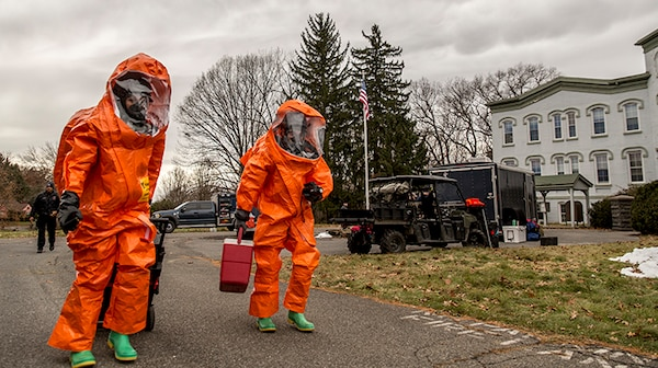 U.S. Army Staff Sgt. Kristin Northrup, a survey team chief, and Spc. Sean Murray, a survey team member, assigned to the 2nd Weapons of Mass Destruction Civil Support Team (CST), New York National Guard, move to inspect, scan and catalog the contents of a simulated bomb maker's vehicle during a hazardous materials exercise with the City of Kingston Fire Department in Kingston, N.Y., Nov. 28, 2018.