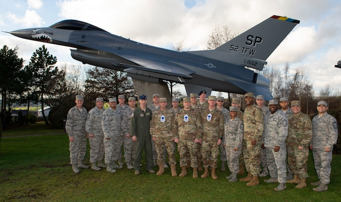 U.S. Air Force Chief Master Sgts. gather around CMSgt. selectees during the promotion release event at the Air Park on Spangdahlem Air Base, Germany, Dec. 4, 2018. Six Senior Master Sgts. assigned to the 52nd Fighter Wing were selected to be promoted to the highest enlisted rank of CMSgt. This rank represents only one percent of the total enlisted force. (U.S. Air Force photo by Airman 1st Class Branden Rae)