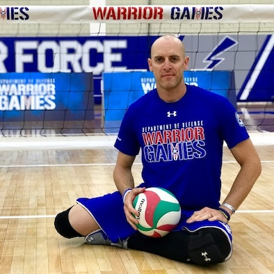 AFOSI Special Agent Bill Lickman, Detachment 223, Tyndall, Air Force Base, Fla., pauses during a break in the sitting volleyball competition at the Department of Defense Warrior Games held at the United States Air Force Academy, Colo., in June 2018. (Photo by AFW2)