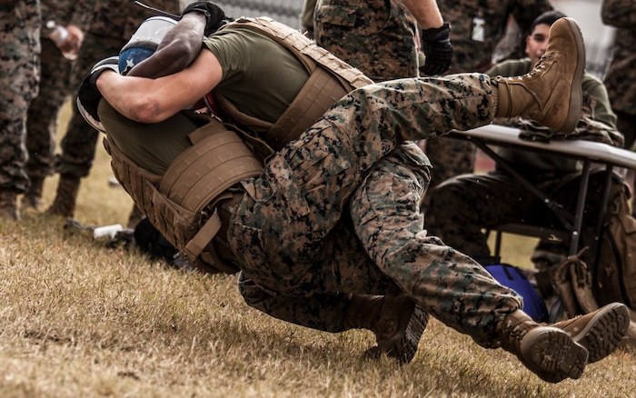 Marines with Marine Corps Support Facility New Orleans get into a tie up during the knife fighting portion of the Marine Forces Reserve King of the Ring tournament, resulting in a tackle with ground hand-to-hand combat during the final seconds of their competition, Nov. 30, 2018. Marine Corps mixed martial arts prepares Marines to quickly take appropriate action whether it be offensively or defensively at any given moment. The MFR King of the Ring tournament is a competition that involves knife fighting, grappling and baton fighting. (U.S. Marine Corps photo by Sgt. Dante J. Fries)