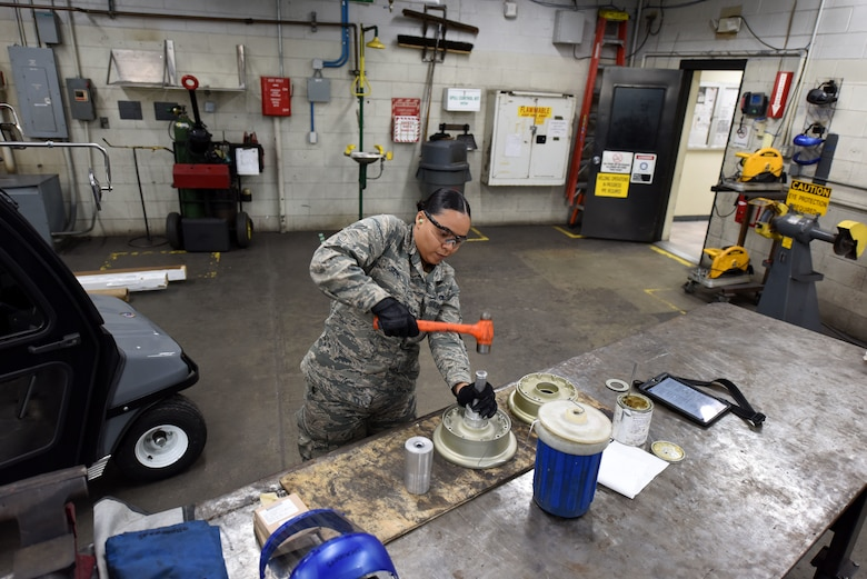 U.S. Air Force Airman 1st Class Sondra Saul, 20th Equipment Maintenance Squadron aircraft metals technician apprentice, hammers a bearing cup inside a wheel bearing in the metal shop at Shaw Air Force Base, S.C., Nov. 30, 2018.