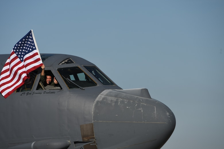 A Reserve Citizen Airman waves a U.S. flag from a B-52 Stratofortress prior to a sortie at Barksdale Air Force Base, Louisiana, March 3, 2017. (U.S. Air Force photo by Master Sgt. Ted Daigle)