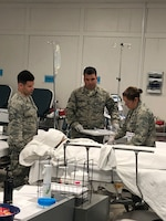 Nineteen members of the 445th Aerospace Medicine Squadron spent a two-week annual tour providing real-world medical support to the 10th Medical Group's Cadet Clinic in a remote area at the U.S. Air Force Academy, Colorado Springs, Colorado. Medical care included preventive medicine, medical evaluation, stabilization of injured cadets and transportation to the triage tent as needed.
