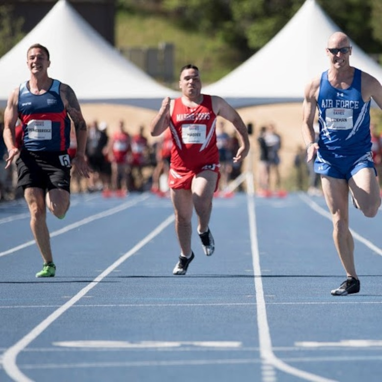 AFOSI Special Agent Bill Lickman, right, of Detachment 223, Tyndall Air Force Base, Fla., staves off competition from sister services during a Department of Defense Warrior Games track event at the United States Air Force Academy, Colo., in June 2018. (Photo by AFW2)