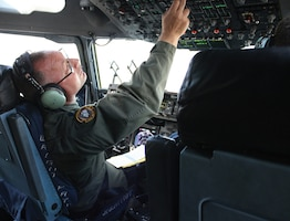 Lt. Col. Bill Barton, 89th Airlift Squadron C-17 pilot, goes through his check list in preparation for takeoff.