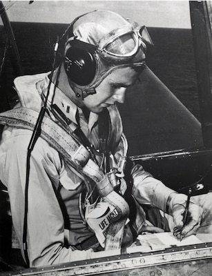 A file photo taken in 1944 of Navy pilot George H. W. Bush in the cockpit of his Grumman TBF Avenger torpedo bomber.
