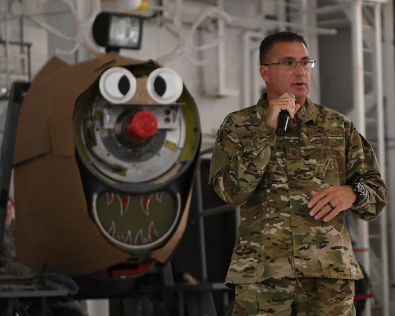 Master Sgt. John Falfas, 910th Airlift Wing career assistance advisor, speaks to 910th Airlift Wing members during the holiday commander's call in Hangar 305 at Youngstown Air Reserve Station, Dec. 1, 2018.