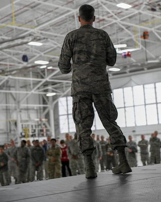Col. Dan Sarachene, 910th Airlift Wing commander, speaks to 910th Airlift Wing members during the holiday commander's call in Hangar 305 at Youngstown Reserve Station, Dec. 1, 2018.