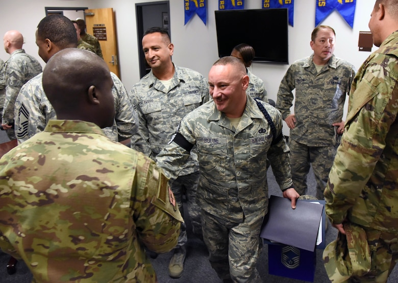 U.S. Air Force Senior Master Sgt. Andrew Bodine, 81st Training Group Military Training superintendent, is congratulated upon the notification of his promotion to the rank of chief master sergeant at Keesler Air Force Base, Mississippi, Dec. 4, 2018. Five senior master sgts. were notified and congratulated for their promotion by the base's leadership and chiefs. (U.S. Air Force photo by Kemberly Groue)