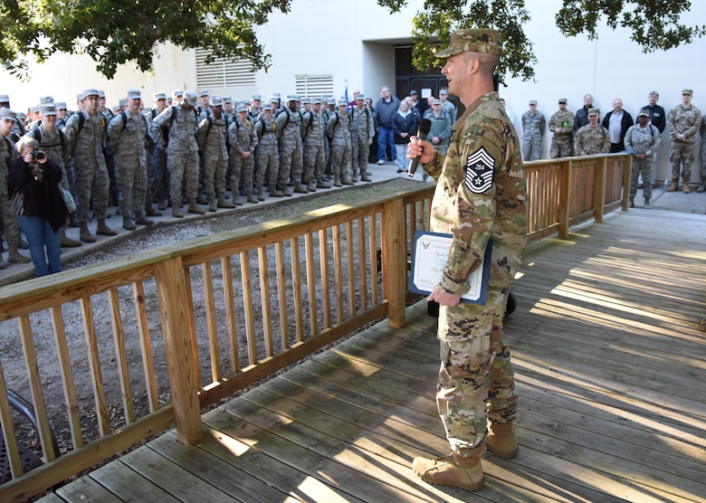 U.S. Air Force Senior Master Sgt. Charles Sargent, 338th Training Squadron flight chief, delivers remarks to technical training students upon the notification of his promotion to the rank of chief master sergeant at Keesler Air Force Base, Mississippi, Dec. 4, 2018. Five senior master sgts. were notified and congratulated for their promotion by the base's leadership and chiefs. (U.S. Air Force photo by Kemberly Groue)