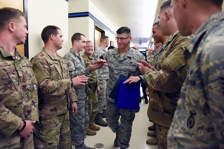 U.S. Air Force Senior Master Sgt. Kevin Lambert, 81st Security Forces Squadron operations superintendent, is congratulated upon the notification of his promotion to the rank of chief master sergeant at Keesler Air Force Base, Mississippi, Dec. 4, 2018. Five senior master sgts. were notified and congratulated for their promotion by the base's leadership and chiefs. (U.S. Air Force photo by Kemberly Groue)