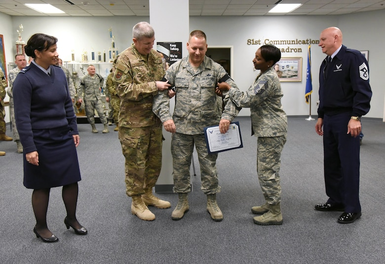 U.S. Air Force Senior Master Sgt. Michael Sterling, 81st Communications Squadron superintendent, receives his new stripes by Keesler leadership upon the notification of his promotion to the rank of chief master sergeant at Keesler Air Force Base, Mississippi, Dec. 4, 2018. Five senior master sgts. were notified and congratulated for their promotion by the base's leadership and chiefs. (U.S. Air Force photo by Kemberly Groue)