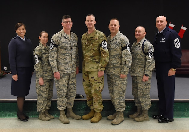 U.S. Air Force Col. Debra Lovette, 81st Training Wing commander, and Chief Master Sgt. David Pizzuto, 81st TRW command chief, pose for a photo with Keesler�s newest chief master sergeant selects at Keesler Air Force Base, Mississippi, Dec. 4, 2018. Senior Master Sgts. Katie Hammonds, 81st Medical Support Squadron medical logistics flight chief; Kevin Lambert, 81st Security Forces Squadron operations superintendent; Charles Sargent, 338th Training Squadron flight chief; Michael Sterling, 81st Communications Squadron superintendent, and Andrew Bodine, 81st Training Group Military Training superintendent, were notified of their selection to the rank of chief master sergeant by base leadership and chiefs. (U.S. Air Force photo by Kemberly Groue)
