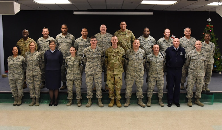 U.S. Air Force Col. Debra Lovette, 81st Training Wing commander, and Chief Master Sgt. David Pizzuto, 81st TRW command chief, pose for a photo with Keesler's newest chief master sergeant selects at Keesler Air Force Base, Mississippi, Dec. 4, 2018. Senior Master Sgts. Katie Hammonds, 81st Medical Support Squadron medical logistics flight chief; Kevin Lambert, 81st Security Forces Squadron operations superintendent; Charles Sargent, 338th Training Squadron flight chief; Michael Sterling, 81st Communications Squadron superintendent, and Andrew Bodine, 81st Training Group Military Training superintendent, were notified of their selection to the rank of chief master sergeant by base leadership and chiefs. (U.S. Air Force photo by Kemberly Groue)