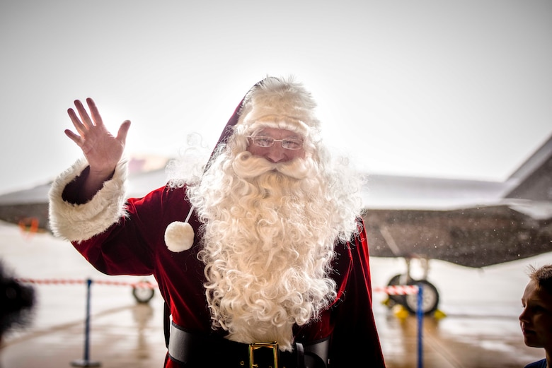 Santa Claus greets 419th Fighter Wing Airmen and their families during the 419th Fighter Wing's annual holiday party