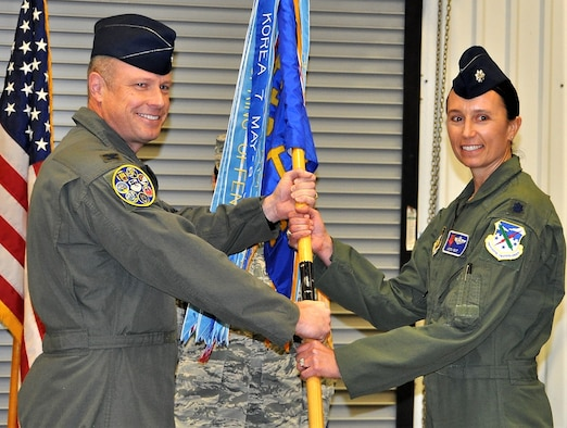Lt. Col. Kristen Kent, right, accepts the 39th Flying Training Squadron guidon from Col. Allen Duckworth, 340th Flying Training Group commander, during an assumption-of-command ceremony held Dec. 6 at Joint Base San Antonio, Texas. (U.S. Air Force photo by Tech. Sgt. Brianne Blackstock)