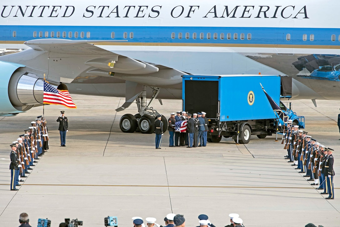 U.S. service members with the Ceremonial Honor Guard carry the casket of George H.W. Bush, the 41st President of the United States, at Joint Base Andrews, Md., Dec. 5, 2018.