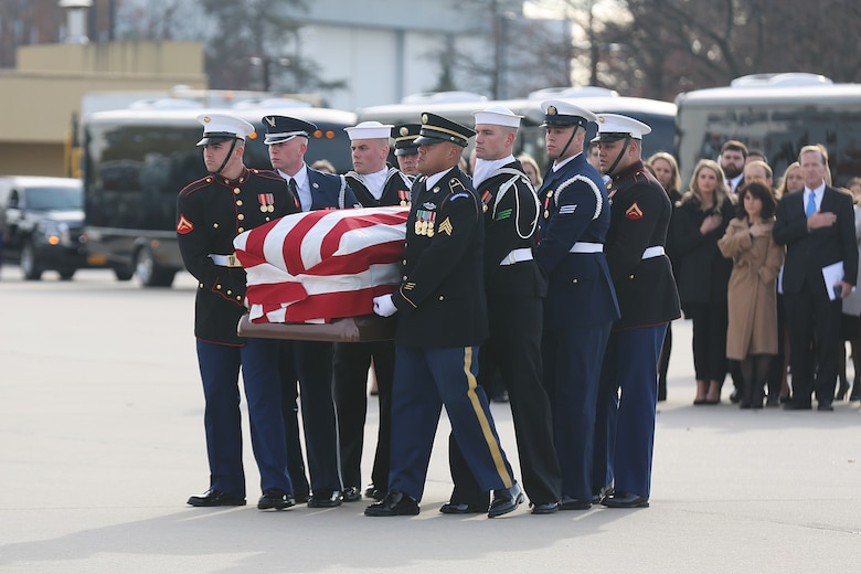 U.S. service members with the Ceremonial Honor Guard carry the casket to Air Force One, Andrews Air Base, Maryland, Dec. 05, 2018.