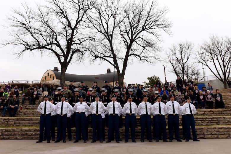 U.S. Soldiers, Marines, Sailors and Airmen from Goodfellow Air Force Base stand during the Hero's Hunt Honor Concert at the Bill Aylor Sr. Memorial RiverStage in San Angelo, Texas, Dec. 6, 2018. Members from San Angelo and Goodfellow AFB participated to thank the wounded veterans. (U.S. Air Force photo by Senior Airman Randall Moose/Released)