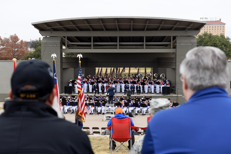 Spectators watch the Central High School Band during the Hero's Hunt Honor Concert at the Bill Aylor Sr. Memorial RiverStage in San Angelo, Texas, Dec. 6, 2018. The Hero's Hunt Honor Concert honors wounded veterans with speeches from local leaders, music by the Central High School Band and recognition from members of San Angelo. (U.S. Air Force photo by Senior Airman Randall Moose/Released)
