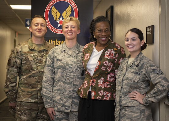 Tech. Sgt. April Spilde, an Equal Opportunity retrainee canidate (second from left), smiles with members of Vandenberg's EO team Dec. 3, 2018, on Vandenberg Air Force Base, Calif.