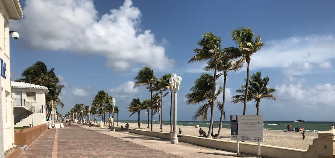 Photo of Hollywood Beach Boardwalk. Two critically eroded areas in Broward County will be renourished starting in early January. A total of 125,000 cubic yards of beach-quality sand will be trucked in from an upland sand mine and placed on the shoreline during the Broward County Segment III beach renourishment project.