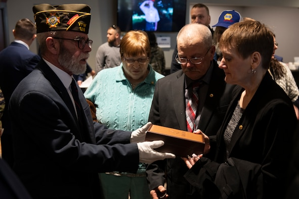 Dawna Duez, mother of U.S. Air Force Staff Sgt. Dylan Elchin, a Special Tactics combat controller with the 26th Special Tactics Squadron, is presented a gift by a Veterans of Foreign Wars member during a memorial service in Moon Township, Pennsylvania, Dec. 6, 2018.