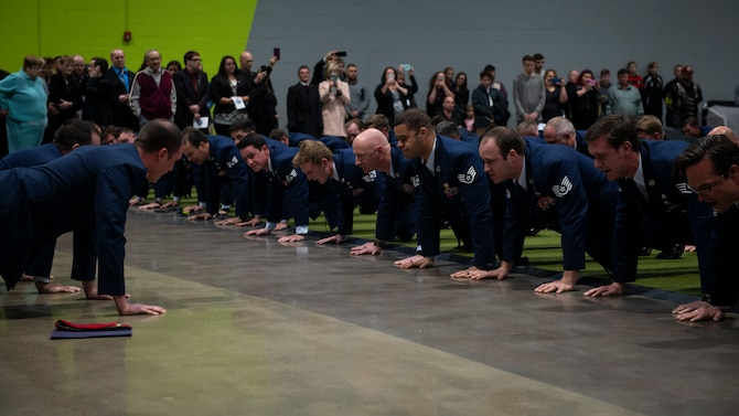 Airmen and family members perform memorial pushups in honor of U.S. Air Force Staff Sgt. Dylan Elchin, a Special Tactics combat controller with the 26th Special Tactics Squadron, during a memorial service in Moon Township, Pennsylvania, Dec. 6, 2018.