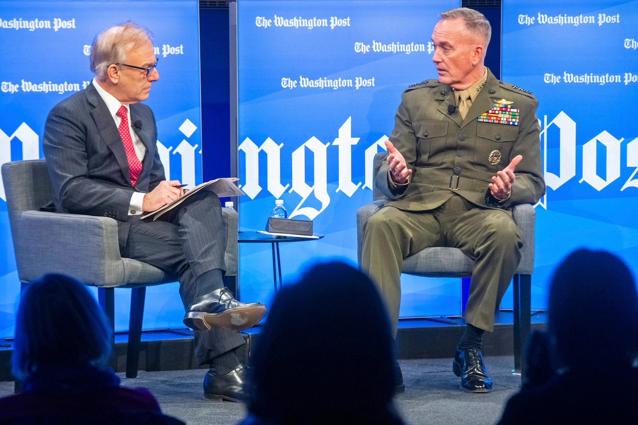Marine Corps Gen. Joe Dunford talks to a moderator during a panel discussion.