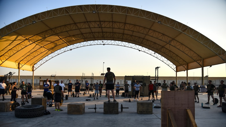 A U.S. Air Force Airman assigned to the 380th Expeditionary Civil Engineer Squadron Explosive Ordnance Disposal flight speaks during the EOD 134 Memorial Workout at Al Dhafra Air Base, United Arab Emirates, Nov. 30, 2018. 380th Air Expeditionary Wing Airmen, along with coalition partners, participated in the workout to honor the 134 EOD technicians from the U.S. Air Force, Army, Navy and Marine Corps that have been killed since Sept. 11, 2001. (U.S. Air Force photo by Senior Airman Mya M. Crosby)